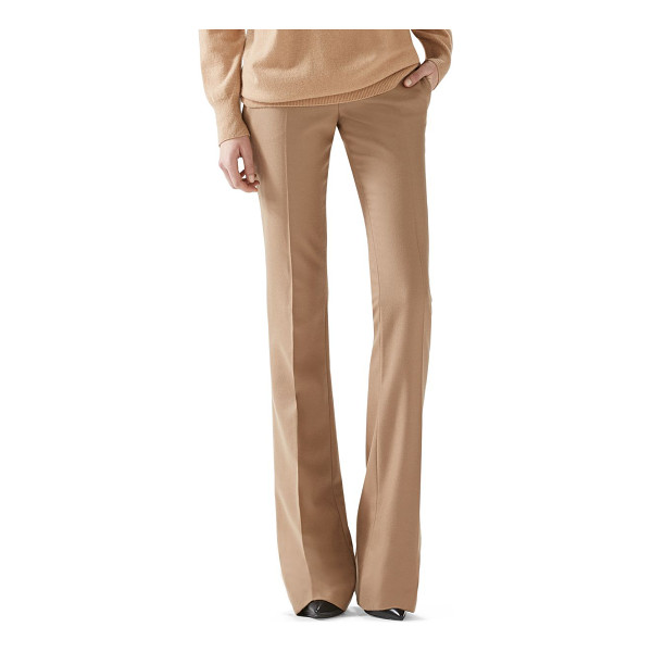 GUCCI Wool flare-leg pants - A mid-rise, flared pant that sets the tone for a refined...
