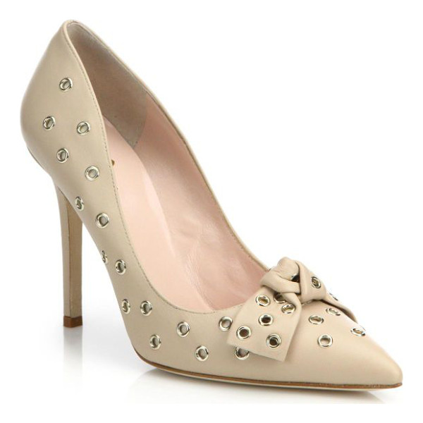 KATE SPADE NEW YORK Lia grommet leather bow pumps - Bold goldtone grommets punctuate a sleek, point-toe...