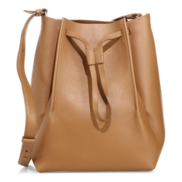MAISON MARGIELA leather bucket bag - Tall structured leather bucket bag with drawstring top....