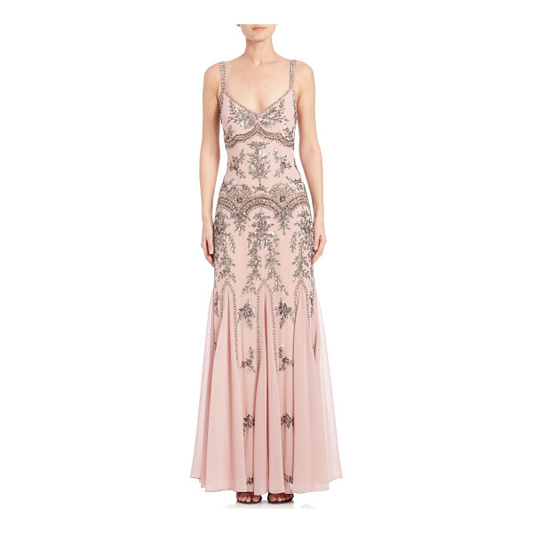 MIGNON sleeveless beaded gown - Intricately beaded gown evokes a vintage aesthetic.V-neck....