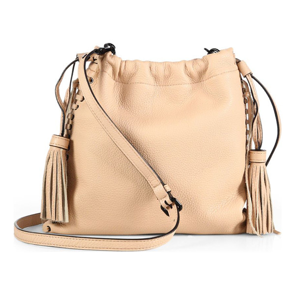 REBECCA MINKOFF Moto leather drawstring crossbody bag - Whipstitched edges, glossy grommets and a chic tassel...