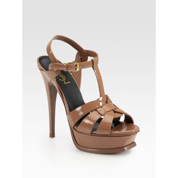 SAINT LAURENT Patent leather tribute platform sandals - A sky-high heel elevates this iconic platform silhouette in...