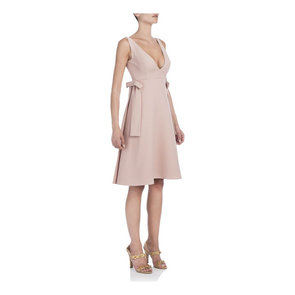 VALENTINO Bow-trim dress - Flared dress with bow accents. Deep V-neck. Sleeveless....