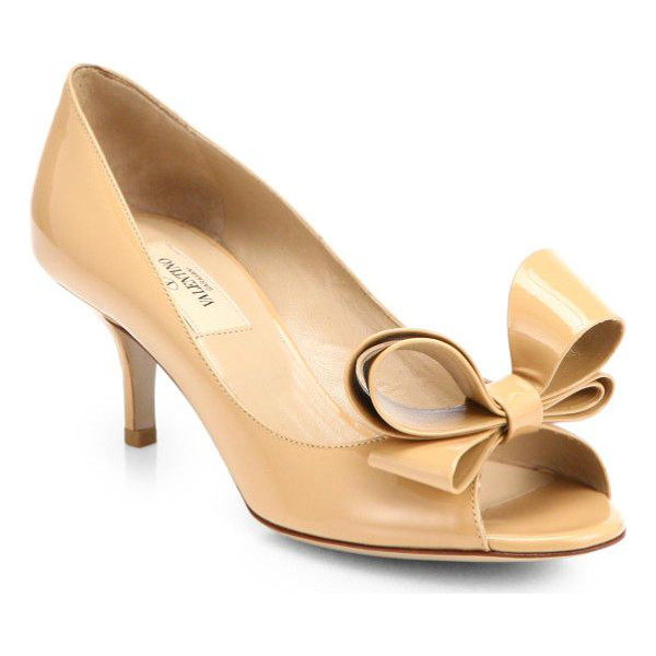 VALENTINO Couture patent leather bow pumps - A signature bow adorns this peep-toe silhouette rendered in...