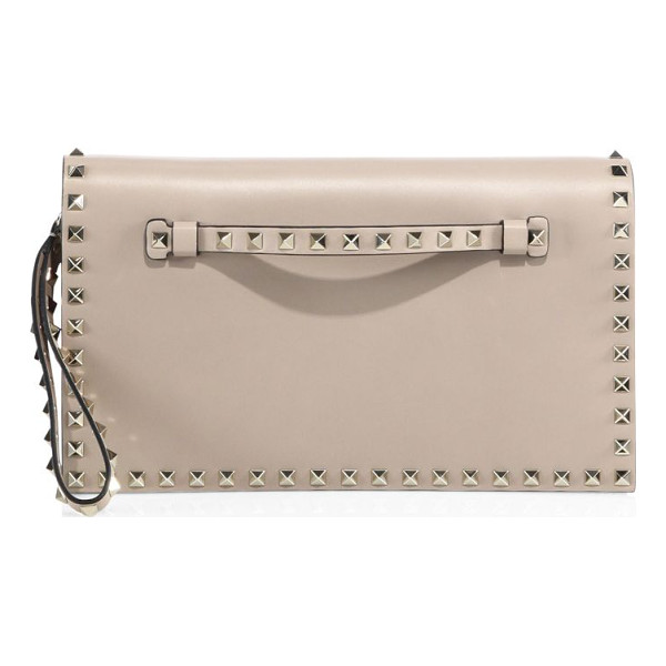 VALENTINO rockstud leather flap clutch - Leather wristlet clutch framed with signature studs....
