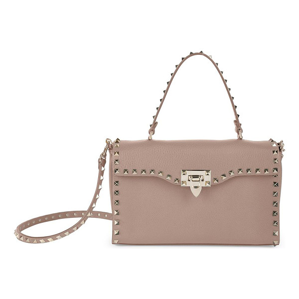 VALENTINO rockstud small leather top-handle bag - Wide leather flap silhouette traced by signature studs. Top...