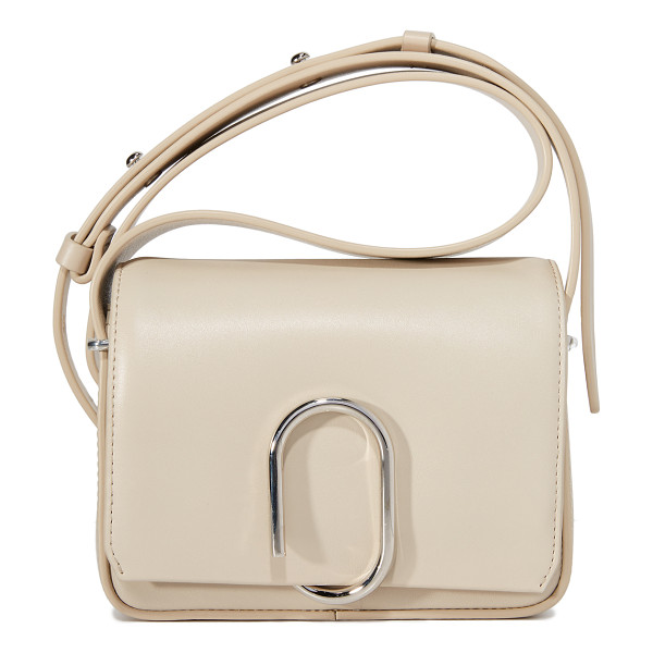 3.1 PHILLIP LIM alix flap shoulder bag - A leather 3.1 Phillip Lim handbag with a coiled clasp in...