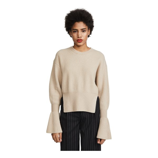 ALEXANDER WANG engineered pullover with side slits - Fabric: Fuzzy ribbed knit Slits at hem Flared cuffs...