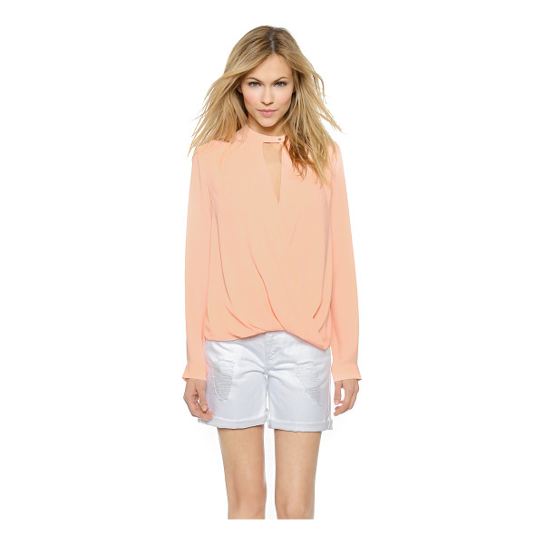 AND B Signature twist front blouse - A bubble hem creates volume on this signature And B blouse,...