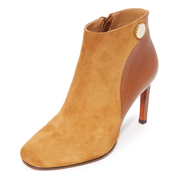 CARVEN Carven Booties - A polished stud accents the top line on these smooth suede...