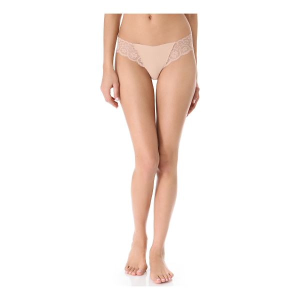 COMMANDO tulip thong - This seamless jersey thong features stretch-lace insets at...