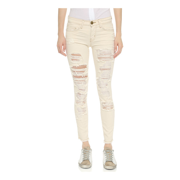 CURRENT/ELLIOTT The stiletto jeans with raw edges - Dramatic shredded holes detail these bleached out Current /...