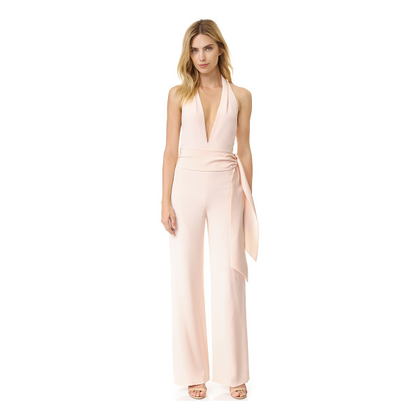 CUSHNIE ET OCHS sleeveless jumpsuit - Draped sashes accent the waist and halter neckline of this...