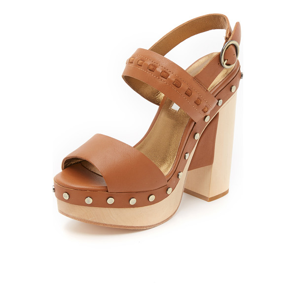 CYNTHIA VINCENT potent clog sandals - Studs accent the wooden platform on these smooth leather...