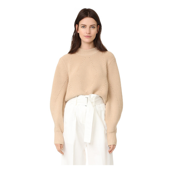 DKNY extra long sleeve pullover with back opening - A cropped DKNY pullover with a mock neckline and crossover...