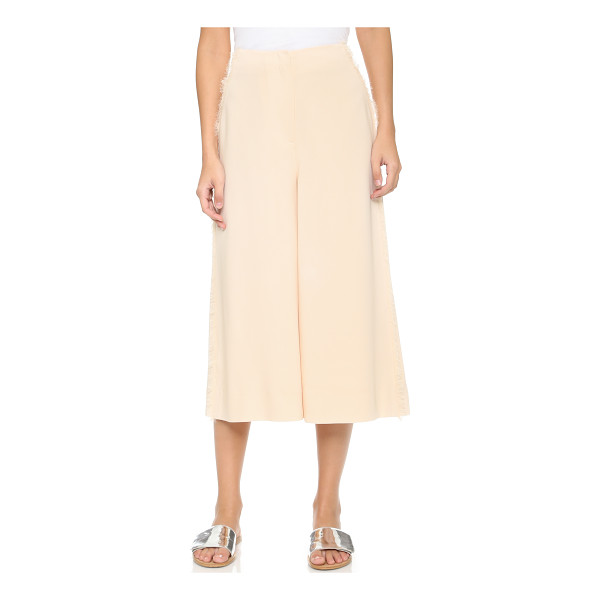 ELIZABETH AND JAMES Frayed presli trousers - Frayed fringe trims the hip pockets and side seams on these...
