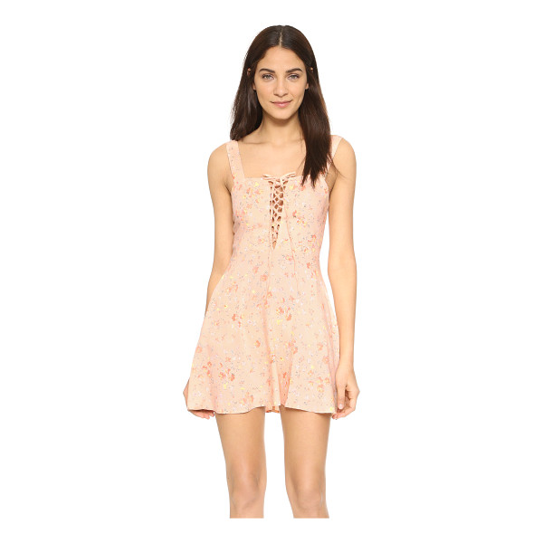 FLYNN SKYE Leila lace up mini dress - A soft floral print complements the feminine feel of this...