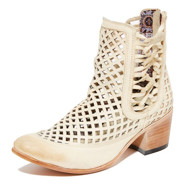 FREEBIRD BY STEVEN lazor booties - Lace-up detailing and geometric cutouts reveal a hint of...