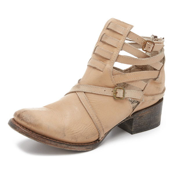 FREEBIRD BY STEVEN Stair booties - Distressed straps and an antiqued buckles accent the cutout...