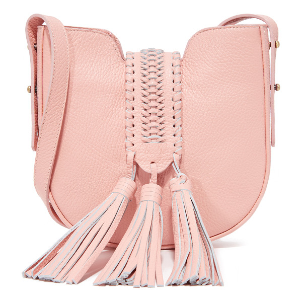 GRACE ATELIER DE LUX baby bohbo bag - A braided magnetic flap with large tassels crosses the top...