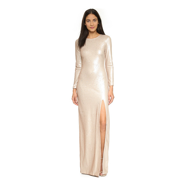HALSTON Sequin gown with high slit - Allover sequins lend sparkle to this dramatic Halston...