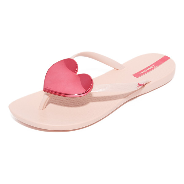 IPANEMA wave heart flip flops - A sculpted, mirrored heart accents the slim thong strap on...