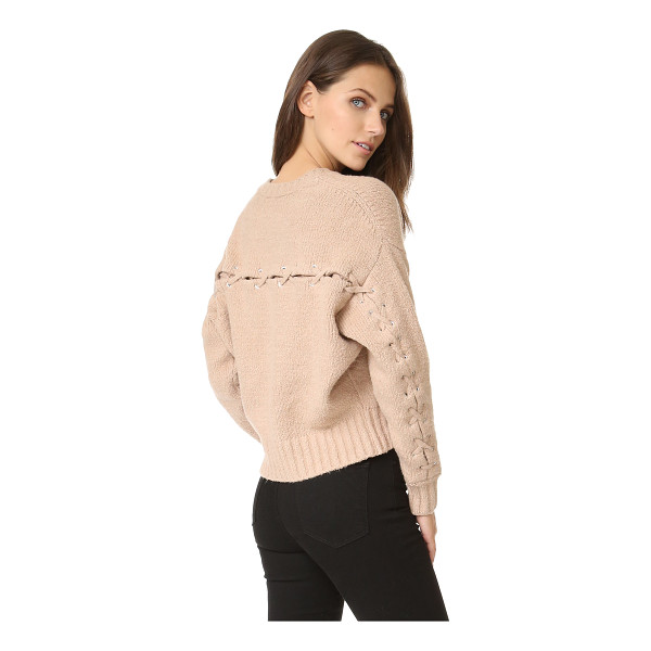 IRO lish sweater - A lace up vent cuts over the back and long sleeves of this...