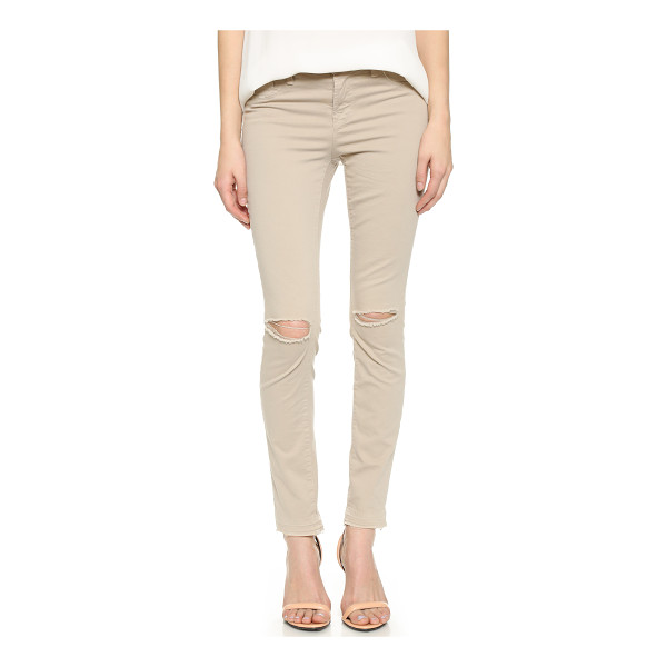 J BRAND 811 mid rise skinny jeans - Faded J Brand pants, styled with raw leg openings and...