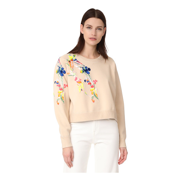 JASON WU crew neck sweater - Asymmetrical floral appliqués add a splash of vibrant color...