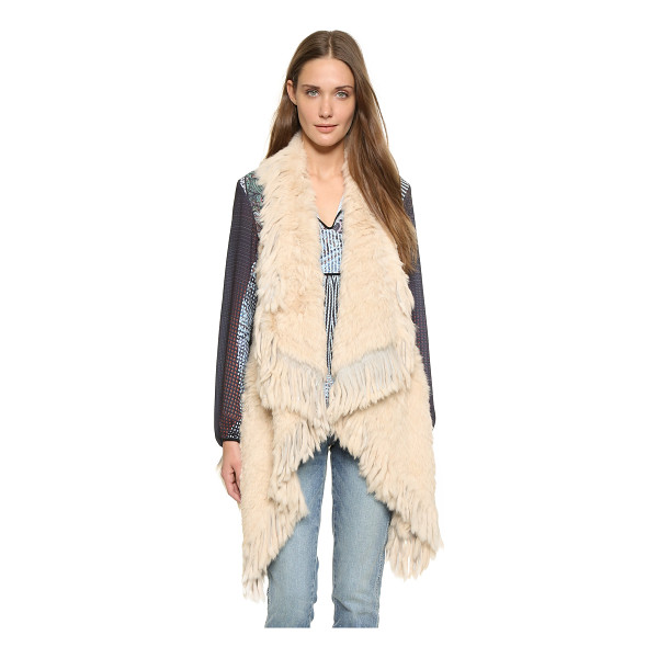 JOCELYN Asymmetrical fringe fur vest - This Jocelyn fur vest has fringed edges for a bohemian...