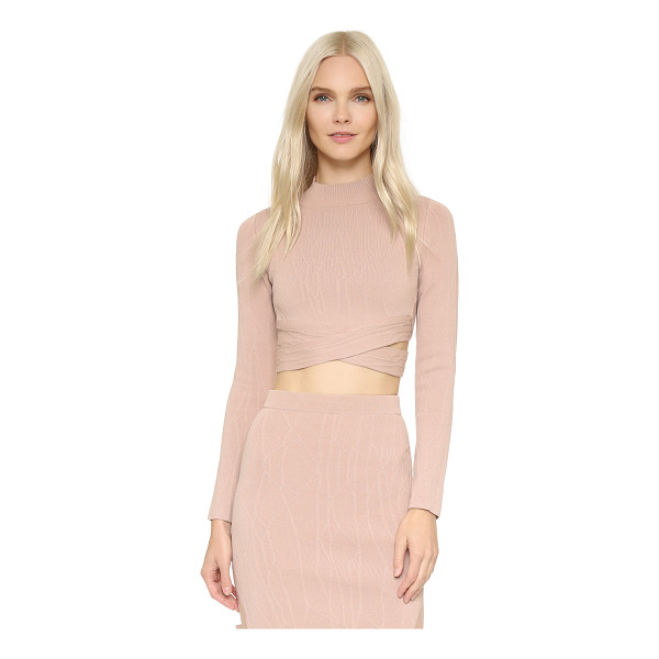 JONATHAN SIMKHAI Spill intarsia knit turtleneck - Open sides crisscrossed with soft banding lend a wrapped...