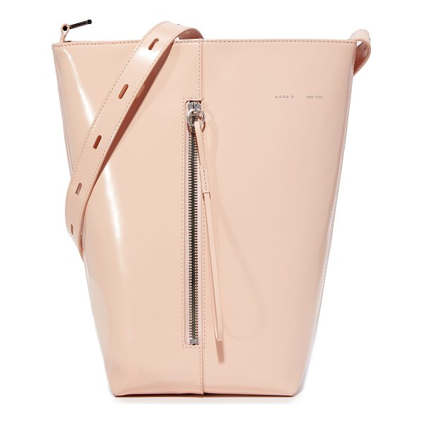 KARA polished panel bucket bag - A structured KARA bucket bag in glossy patent leather....