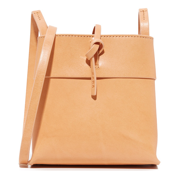 KARA nano tie cross body bag - A petite KARA bag with a minimalist silhouette. A thin tie