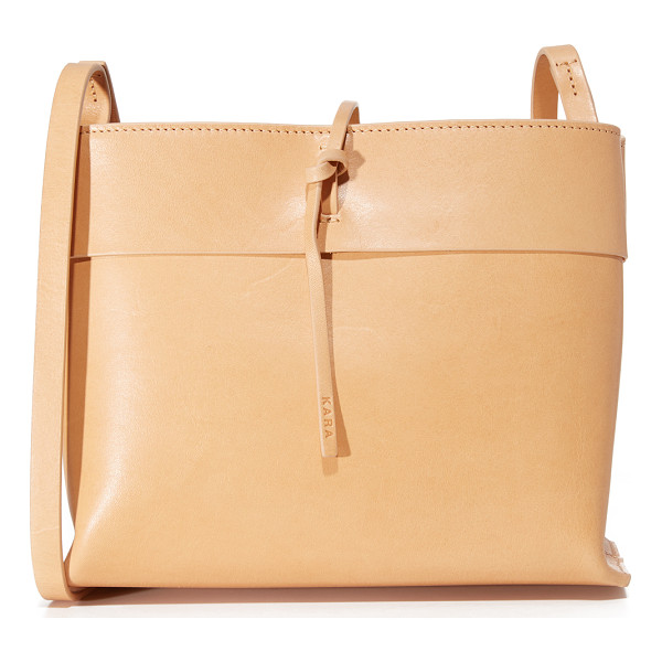 KARA tie cross body bag - A streamlined KARA cross-body bag in smooth leather. A slim...