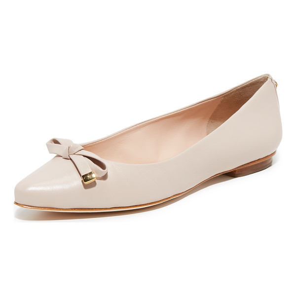 KATE SPADE NEW YORK Emma Flats - A knotted bow with metallic detailing accents the pointed...