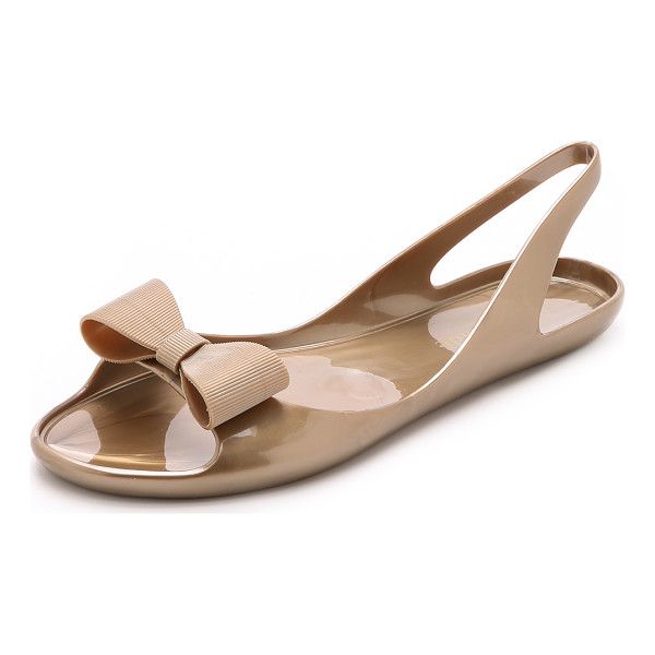 KATE SPADE NEW YORK Odessa jelly sandals - A structured bow accents the vamp of these metallic rubber...