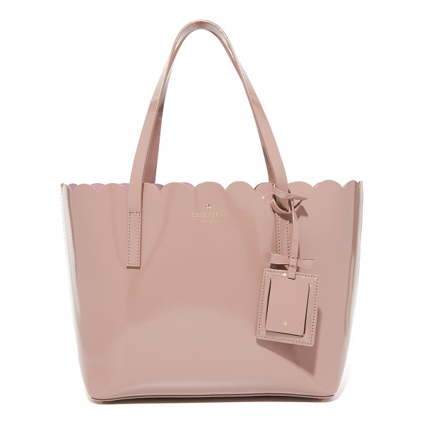 KATE SPADE NEW YORK Small carrigan tote - A scalloped top line adds charm to this patent leather Kate
