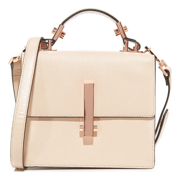KENDALL + KYLIE mini minato top handle bag - Edgy hardware accents this sophisticated KENDALL + KYLIE...