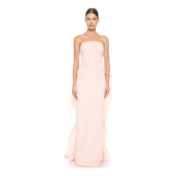 MARCHESA Strapless silk faille column gown - Cascading ruffles flow in gentle curves over the back of...