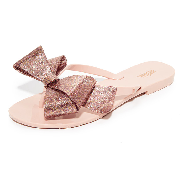 MELISSA harmonic bow iii flip flops - A bold, glittery bow details the thong strap on these...