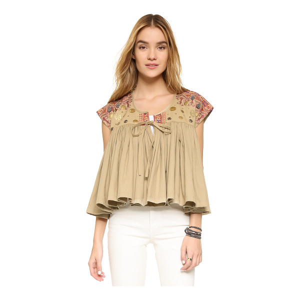MES DEMOISELLES Myriade top - Smooth embroidery and metal medallions lend an eclectic...
