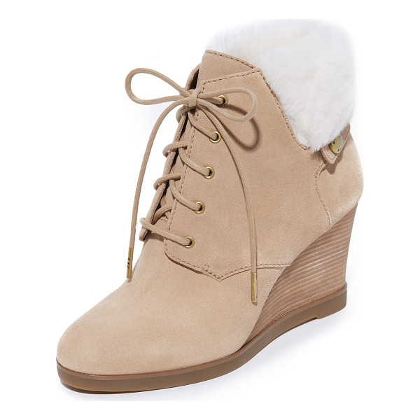 MICHAEL MICHAEL KORS carrigan shearling wedge booties - A soft shearling cuff and a logo stud trims these velvety...