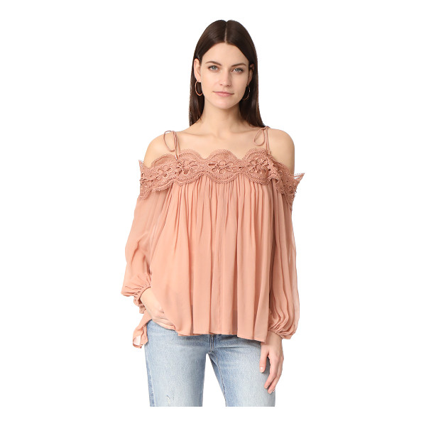 MINISTRY OF STYLE shells top - Guipure lace accents the neckline of this airy chiffon...