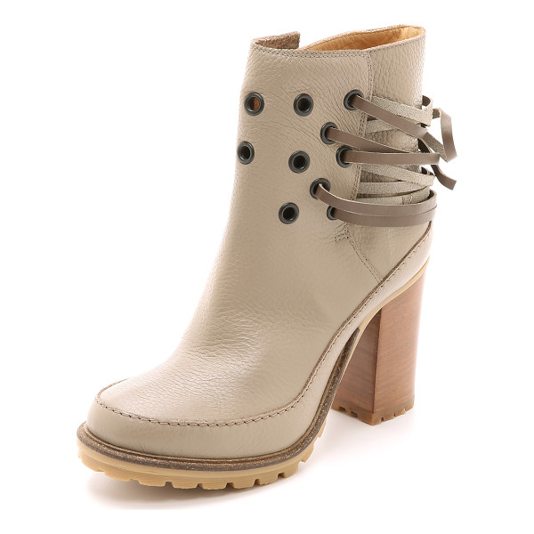 MM6 MAISON MARGIELA Grommet booties - MM6 booties with a strong, substantial look. Contrast...
