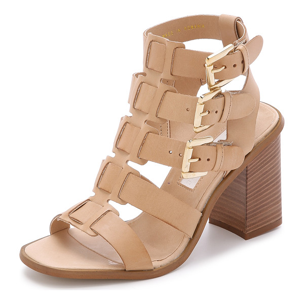 MODERN VINTAGE SHOES Orphia buckle sandals - Leather straps weave though the center of these Modern...