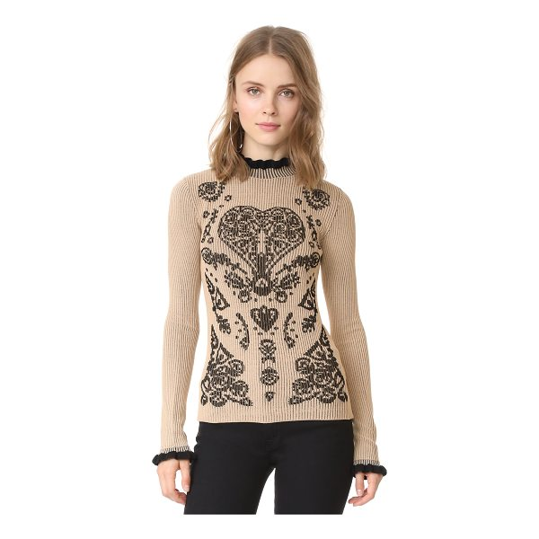 RED VALENTINO printed sweater - A formfitting RED Valentino sweater with a dark heart...