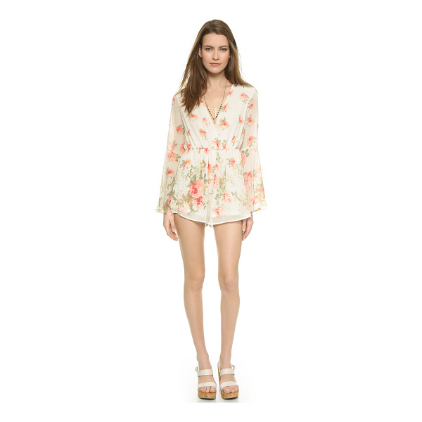 REVERSE Bell sleeve romper - Rose prints accent this airy Reverse romper. Plunging...