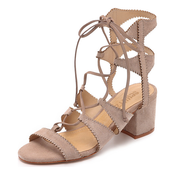 SCHUTZ Latisha city sandals - These lace up Schutz sandals are fashioned in scalloped...