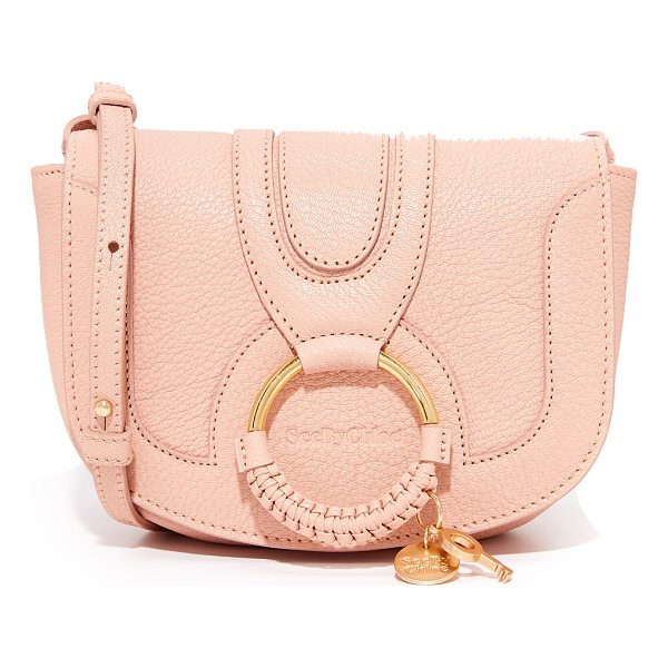SEE BY CHLOE hana small saddle bag - A See by Chloé saddle bag in pebbled leather. A matte ring...