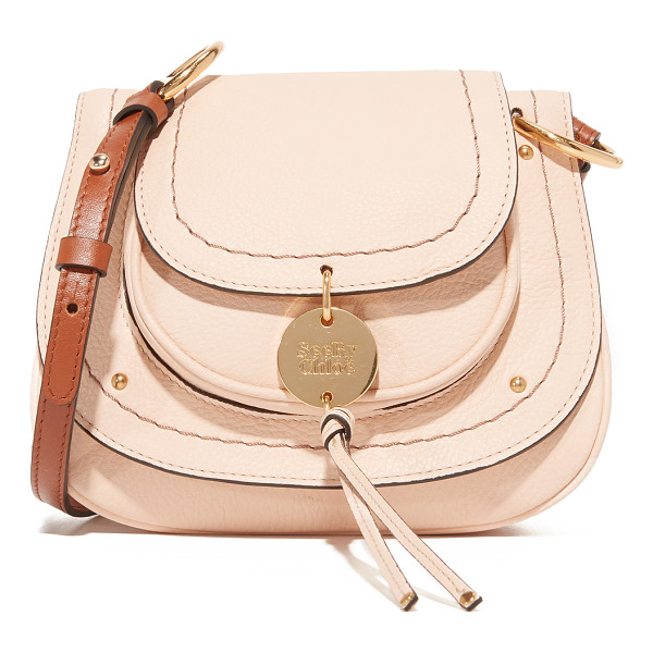 SEE BY CHLOE susie small saddle bag - A pouch pocket with a decorative logo charm covers the...